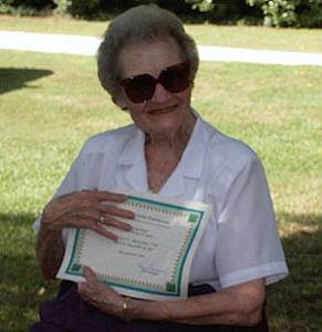 Helen Brewington shows her 80+ Certificate
