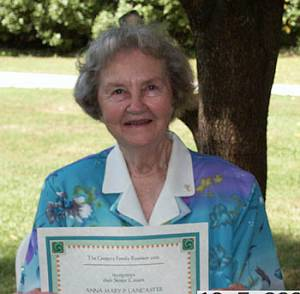 Anna Mary P. Lancaster shows her 80+ Certificate
