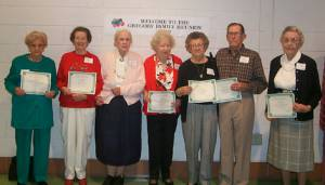 A group picture of the oldest attendees displaying their certificates