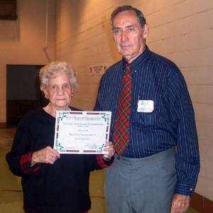 Ben Gregory with Doris Frazier displaying her senior attendee certificate