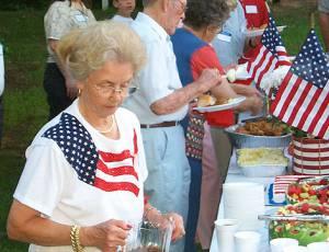 Barbara Gregory serving iced tea